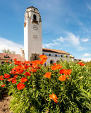 Flower garden at a local city park with waterfall and Depot Royalty Free Stock Images