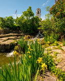Flower garden at a local city park with waterfall and Depot Stock Photography