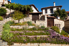 Flower-garden. Traditional Bulgarian houses and garden flowers merged Royalty Free Stock Image