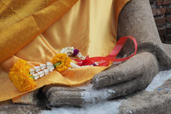 Flower garland in Buddha's hand. Close-up of a flower garland in Buddha's hand at Wat Yai Chai Mongkon, a Buddhist temple in Ayutthaya, Thailand Royalty Free Stock Photo