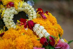 Flower garland comprise of jasmines, roses, gardenias and ervatamias on the Buddha image. Prepared for water pouring in Songkran festival stock image