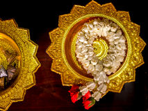 Flower garland. On golden tray Stock Images