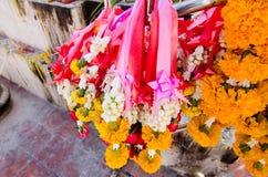 Flower garland sacrificial worship sacred Buddhist faith. Stock Image