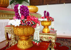 Flower garland in tray with pedestal. For paying homage in wedding ceremony Stock Photos