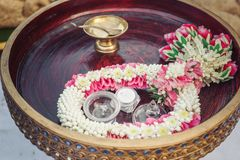 Flower Garland on wood plate.  stock images