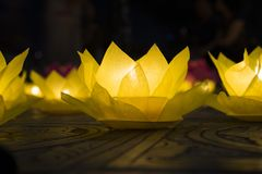 Flower garlands and colored lanterns for celebrating Buddha`s birthday in Eastern culture. They are made from cut paper and candl Royalty Free Stock Photography
