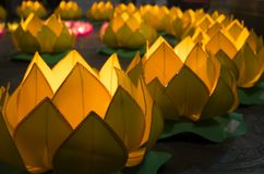 Flower garlands and colored lanterns for celebrating Buddha`s birthday in Eastern culture. They are made from cut paper and candl Royalty Free Stock Photo
