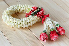 Flower garlands in Thai style. Image of Flower garlands in thai style on the wood background, it is used for giving to Buddha, parent, teacher or seniority Royalty Free Stock Photo