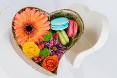 Flower gerbera and macaroon in heart shaped box Stock Photo