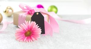 Flower and giftbox. And black tag for greeting stock image
