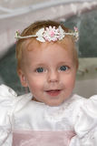 Flower Girl. Beautiful little flower girl with garland on her head Stock Image