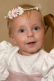 Flower Girl. Beautiful little flower girl with garland on her head Stock Photo