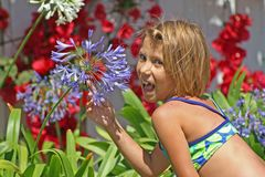 Flower Girl. Me in my garden. Little girl enjoying the flowers Royalty Free Stock Photos