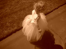Flower girl. In a white dress - sepia photograph Stock Images