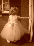 Flower girl. In a white dress - sepia photograph Royalty Free Stock Image