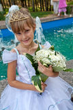 Flower girl. Wearing the bridal diadem holding a bouquet of flowers Stock Photography