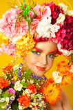 Flower Girl. Beautiful young girl wearing flower wreath. Creative makeup with long feather artificial eyelashes and bright colorful eyeshadow stock photos