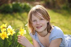 Flower girl. Portrait of a teenage girl in the garden beneath some yellow flowers Stock Photography