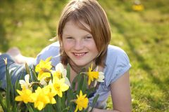 Flower girl. Portrait of a teenage girl in the garden beneath some yellow flowers stock photos