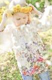 Flower girl. Cute girl in the field of flowers Stock Image