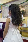 Flower Girl. At a wedding in an informal setting.  Back view; model's face cannot be seen Royalty Free Stock Photos