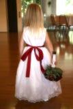 Flower girl. The back side of the flower girl showing off her dress Stock Photo