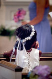 Flower girl. A girl at a wedding, during the ceremony royalty free stock photography