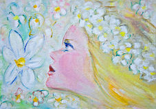 Flower girl. The beautiful, blond flower gir, is surrounded by a garden of white flowers Stock Images