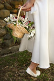Flower Girl. A side view of a flower girl with a lovely basket of flowers Stock Images