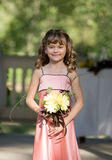 Flower Girl. Smiling Holding Her Flowers royalty free stock photos