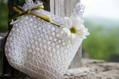 Flower girl basket at a wedding. Flower girl basket at an outdoor wedding in the mountains Royalty Free Stock Images