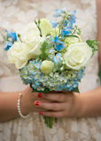Flower girl bouquet. Wedding bouquet in hands of child flower girl Royalty Free Stock Image