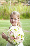 Flower girl with bouquet. Portrait of Caucasian flower girl with bouquet smiling Stock Image