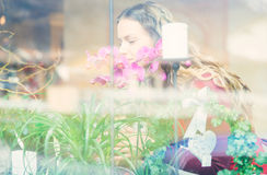 Flower girl in her flowers and plants store Stock Photography