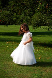 Flower Girl Side View. Four year old flower girl dancing outside Stock Photography