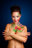 Flower-girl. Studio portrait of a girl with flower body-art Royalty Free Stock Photography