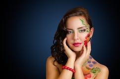 Flower-girl. Studio portrait of girl with body art stock image