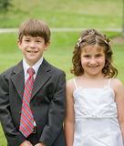 Flower Girl and Young Boy Royalty Free Stock Images