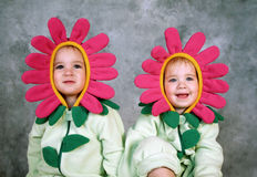 Flower Girls. Two little girls are dressed up as pink flowers and smile at the camera Royalty Free Stock Photos