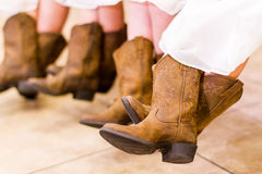 Flower girls. Cute flower girls in cowboy boots before the wedding Stock Images