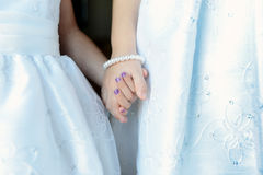 Flower Girls holding hands. Loving shot of two young girls possibly on wedding day or first communion.. a celebration of any soft. Conveys sisterhood, friendship stock photography