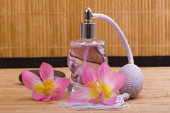 Flower and glass perfume bottle Stock Photography