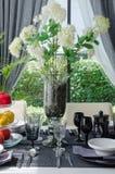 Flower in glass vase on dinnig table Stock Photo