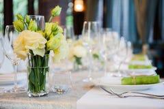 Flower glasses set in restaurant Stock Photo