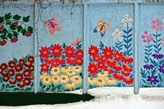 Flower graffiti on a concrete wall. Summer art on the fence during winter royalty free stock photos