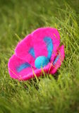 Flower on the grass. Felted flower lying on the grass Royalty Free Stock Images