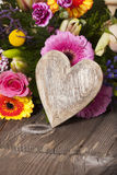 Flower Greetings with a Wooden Heart Royalty Free Stock Images