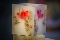 Flower guards. Flower got in a candle in order that this one is aromatic Stock Photos