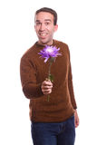 Flower Guy. A young guy is holding a large flower, isolated against a white background Stock Images
