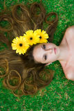 Flower in hair Royalty Free Stock Images